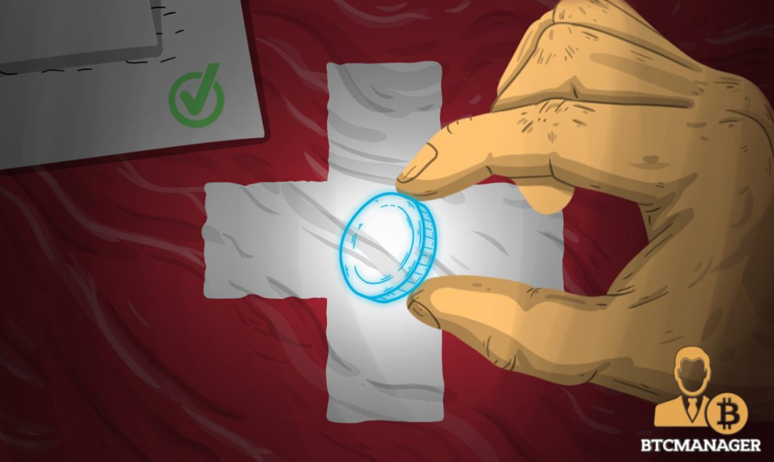 Hand Holding a Holographic Coin with Swiss Flag in the Background
